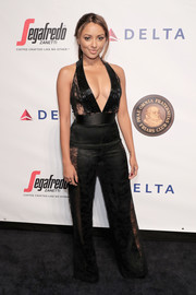 Kat Graham stole the spotlight in a plunging black lace-panel jumpsuit by Thai Nguyen Atelier that she paired with Kris Nations jewelry at the Friars Club event honoring Martin Scorsese.
