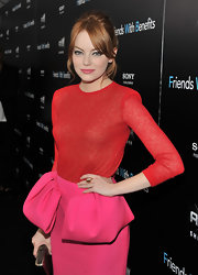 Emma Stone paired her hot pink pencil skirt with a vibrant red crewneck sweater from the same Valli collection. The red-head looked spectacular with a sweet updo and gold accessories.