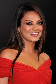 Red hot starlet Mila Kunis paired her sexy Lanvin dress with sleek locks and smoky eyes.