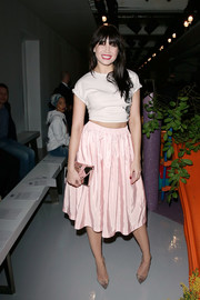 For her bag, Daisy Lowe chose a mirrored clutch with pink trim.