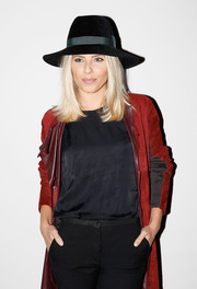 Mollie King looked cool in her black Kurt Geiger fedora while attending the Pringle of Scotland fashion show.