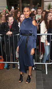 Alesha Dixon looked oh-so-cool in a blue cold-shoulder midi dress with an asymmetrical hem and an open back during the Topshop Unique fashion show.