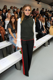 Olivia Palermo pulled her outfit together with a pair of black side-striped pants, also by Zara.
