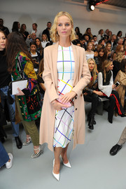 Eva Herzigova looked ready for fall in her nude wool coat while attending the Mary Katrantzou fashion show.