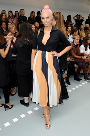 Amber Le Bon showed some cleavage in a black shirt which she wore unbuttoned halfway down during the Mary Katrantzou fashion show.