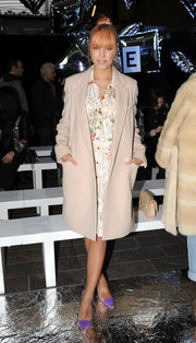 Amber Le Bon arrived at the Mary Katrantzou fashion show wearing a nude wool coat over a lace dress.