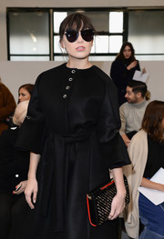 Daisy Lowe topped off her ensemble with a pair of cateye sunnies.