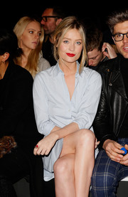 Laura Whitmore paired a red ring with her pastel-blue dress at the E. Tautz fashion show.