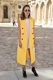 Paola de Orleans e Braganca was punk-chic in a sleeveless yellow Christian Dior coat layered over a pink mini during the label's fashion show.