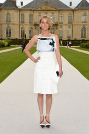Jennifer Lawrence chose a pair of modern-chic two-tone ankle and diagonal-strap pumps by Christian Dior to complete her outfit.