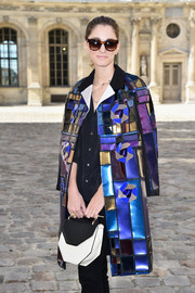 Sofia Sanchez Barrenechea attended the Dior show carrying a modern-chic geometric purse by M2Malletier.