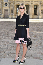 Lala Rudge looked classy at the Dior show in a black coat styled with a gold belt.