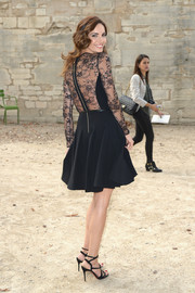 Eugenia Silva flaunted plenty of skin in a sheer-back LBD during the Elie Saab fashion show.