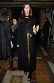 Christina Pitanguy arrived for the Lanvin fashion show wearing a flowing black wool coat.
