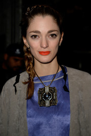 Sofia Sanchez Barrenechea accessorized with a square pendant necklace that was eye-catching both for its size and for its unique and chic design.