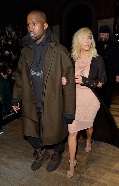 More Pics of Kanye West Wool Coat (1 of 13) - Kanye West Lookbook - StyleBistro [outerwear,fashion,event,coat,fashion design,fawn,kanye west,kim kardashian,front row,part,paris,france,lanvin,paris fashion week womenswear fall,show]
