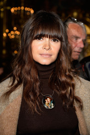 Miroslava Duma looked boho-cute with her long waves and eye-grazing bangs at the Stella McCartney fashion show.