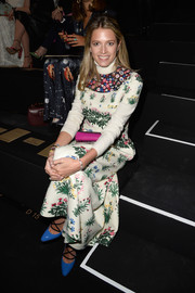 Helena Bordon looked charming at the Valentino fashion show in a maxi dress featuring a lovely mix of florals.