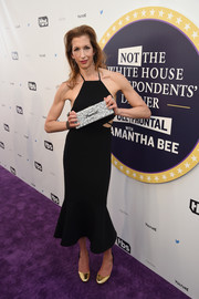 Alysia Reiner topped off her ensemble with a silver 'Feminist' box clutch.