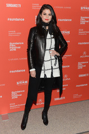 Selena Gomez layered a black leather and wool biker coat by Givenchy over a Tory Burch sweater for the 'Fundamentals of Caring' premiere.