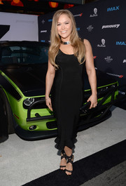 Ronda Rousey got all dolled up in a body-con, ruffle-hem LBD for the LA premiere of 'Furious 7.'