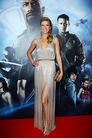 Adrianne Palicki opted for this glamorous gold evening gown with a front slit and open back for her red carpet look.