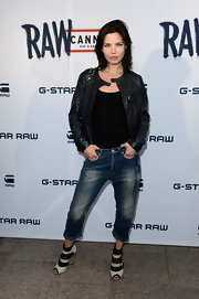 Delphine Chaneac arrive at the G-Star store opening at Cannes wearing a pair of cutout ankle boots.