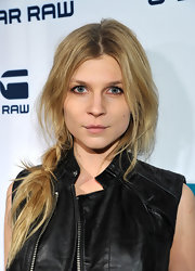 Clemence Poesy wore her long tresses in a casual messy side braid at the G-Start Rodeo Drive store opening.
