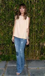 Catt Sadler toughened up her top with a pair of ripped jeans.