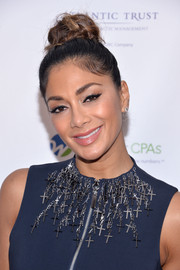 Nicole Scherzinger sported a trendy top knot at the GEMS' Love Revolution Gala.