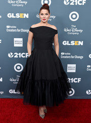 Debra Messing was classic and romantic in a black bardot dress by Christian Siriano at the GLSEN Respect Awards.