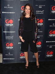 Evangeline Lilly kept it relaxed in black capris and a matching top at the 2018 GO Campaign Gala.