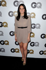 Olivia Munn paired a neutral chiffon dress with platform leopard pumps. The heels added a sultry touch to her ladylike dress.