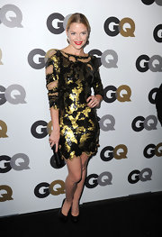 Jaime King paired a gilded cocktail dress with versatile black patent pumps. Red lips complete her look.