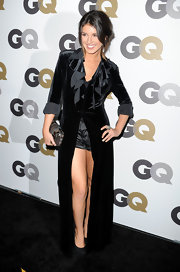 Shenae showed off black platform plumps and a whole lot of leg  at the GQ Men of the Year Party. She paired the heels with satin evening shorts and a velvet floor length coat.