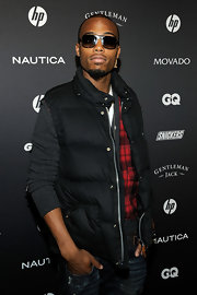 B.o.B completed his flannel shirt and classic jeans with a black puffy jacket.