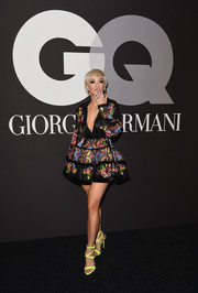 Rita Ora attended the GQ and Giorgio Armani Grammy after-party looking flirty in a Dsquared2 floral dress with a deep-V neckline and a tiered skirt.
