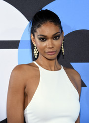Chanel Iman polished off her look with a pair of gold chandelier earrings.