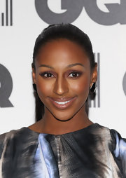Alexandra Burke rocked glossy nude lips at the GQ Men of the Year Awards. To try her look, we recommend a product like Stila Lip Glaze in Brown Sugar. It's a soft, shimmering neutral that works with most skin tones.