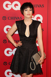 Megan Washington accessorized with a nude and black houndstooth clutch when she attended the GQ Men of the Year Awards.
