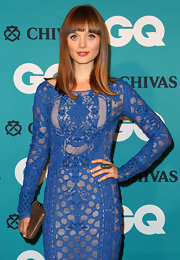 Bella Heathcote looked like a doll with her long straight locks and bangs at the GQ Men of the Year Awards.