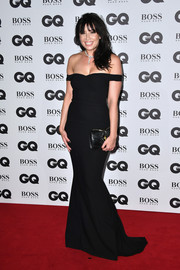 Daisy Lowe complemented her dress with an embellished black leather clutch.