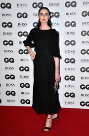Erin O'Connor opted for an understated look with this black midi dress at the GQ Men of the Year Awards.