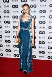Lily Cole was a classic beauty in her Luisa Beccaria gown, featuring pink floral embroidery on a blue velvet background, at the GQ Men of the Year Awards.