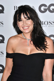 Daisy Lowe paired her low-cut dress with a diamond snake necklace by Bulgari.