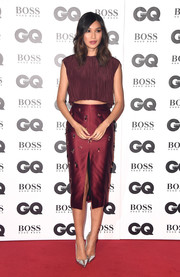 Gemma Chan punctuated her burgundy separates with silver pumps.