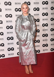 Rose McGowan made a head-turning entrance in a silver trenchcoat by Osman at the 2018 GQ Men of the Year Awards.