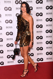 Dua Lipa walked on the wild side in a one-sleeve leopard-print dress by Saint Laurent at the 2018 GQ Men of the Year Awards.