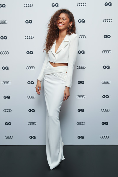 Zendaya Coleman looked modern and sassy in this white cropped jacket and maxi skirt combo by Monot at the 2019 GQ Men of the Year Awards.