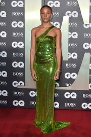 Adwoa Aboah looked disco-ready in a shimmering acid-green one-shoulder gown from the Gucci Fall 2004 collection at the 2019 GQ Men of the Year Awards.